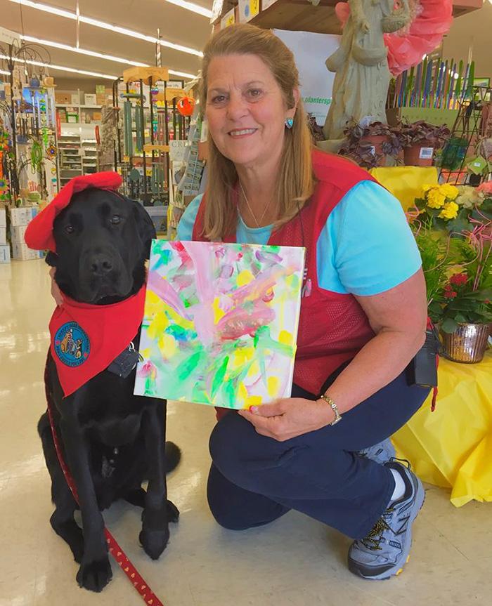 собака которая умеет рисовать