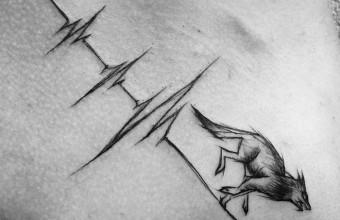 Необычная татуировка волка